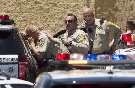 Metro Police officers are shown outside a Wal-Mart after a shooting in Las Vegas June 8, 2014. REUTERS/Las Vegas Sun/Steve Marcus