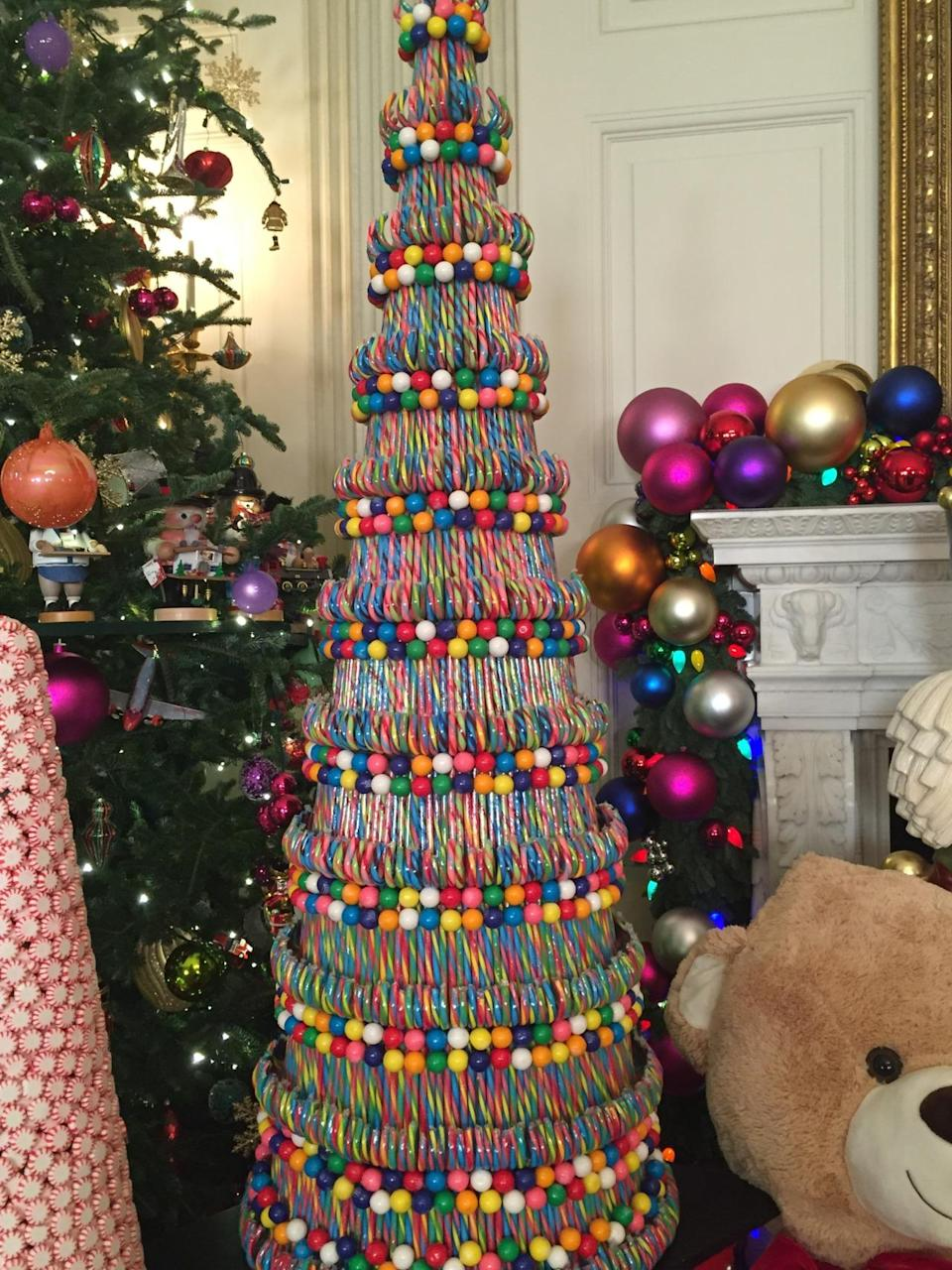 <p>A tree made of candy canes and gum balls sits next to a peppermint candy tree and a six-foot-tall teddy bear in the State Dining Room. <i>(Photo: Cassie Carothers)</i></p>