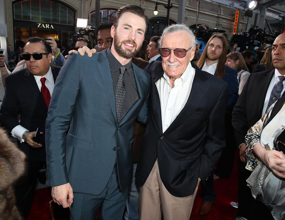 "Chris Evans, left, and Stan Lee arrive at the Los Angeles premiere of ""Captain America: Civil War"" at the Dolby Theatre on Tuesday, April 12, 2016. (Photo by Matt Sayles/Invision/AP)"
