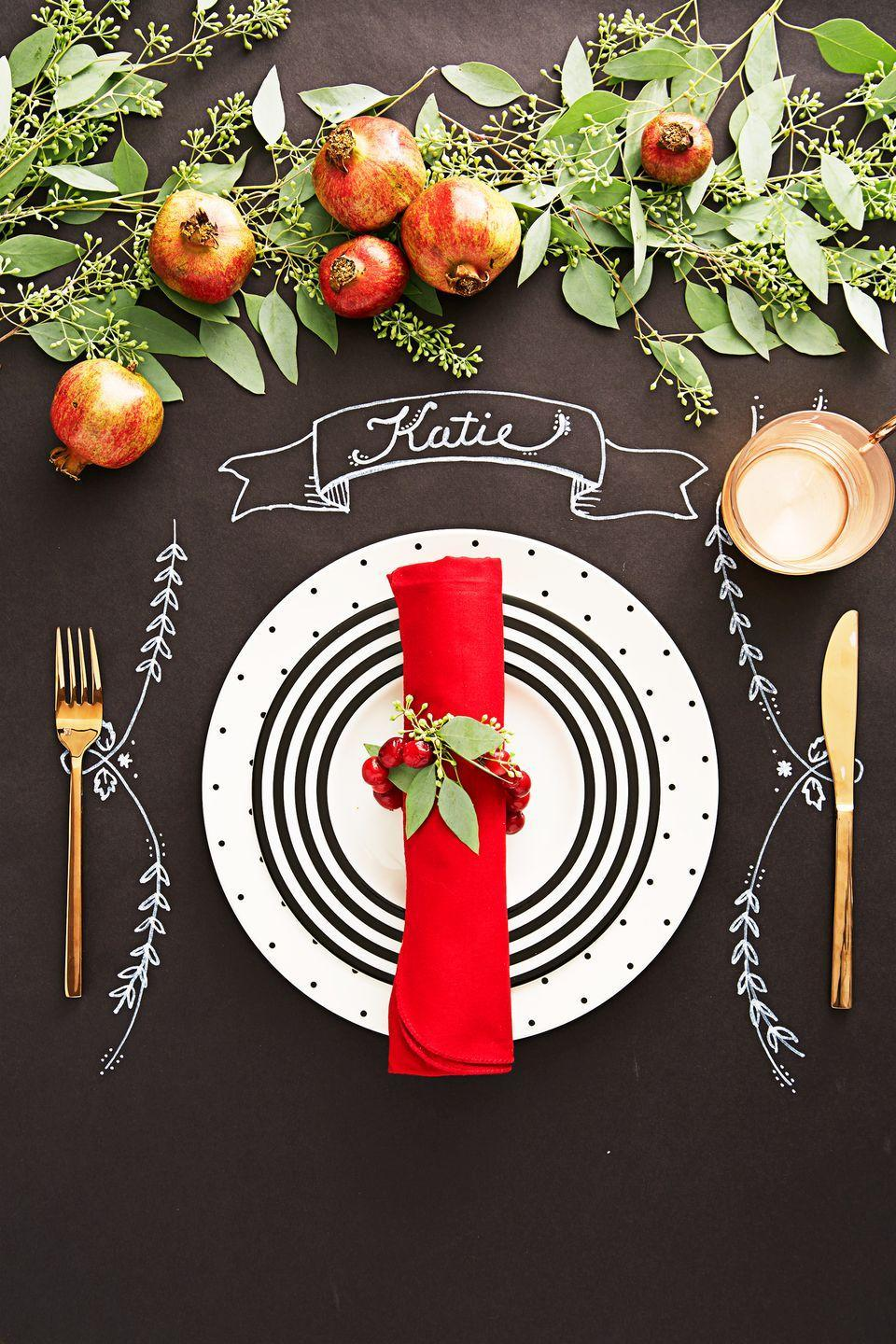 <p>Ditch a fussy tablecloth and use black butcher paper instead. This way, you can decorate it however you want. You can channel your inner artist with a paint pen and draw on decorative details and/or customize place cards, and hey, it makes cleaning up after a holiday dinner much easier.</p>