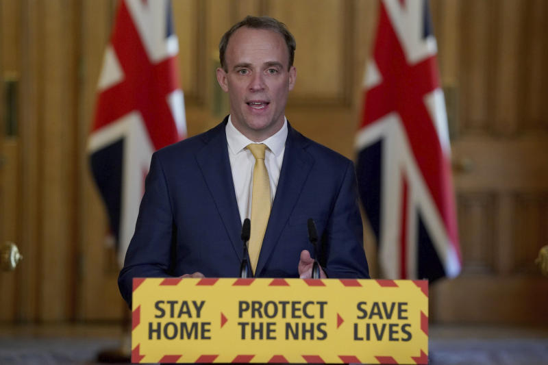 In this photo provided by 10 Downing Street, British Foreign Minister Dominic Raab speaks at a press conference on the coronavirus in Downing Street, London, Tuesday, April 7, 2020. British Prime Minister Boris Johnson is remained in intensive care Tuesday with a coronavirus at the NHS St Thomas Hospital in central London. The new coronavirus causes mild or moderate symptoms for most people, but for some, especially the elderly and people with existing health conditions, it can cause more serious illness or death. (Pippa Fowles / 10 Downing Street via AP)