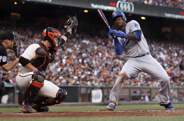 Los Angeles Dodgers' Hanley Ramirez, right, dodges a high pitch from San Francisco Giants pitcher Ryan Vogelsong during the sixth inning of a baseball game on Saturday, July 26, 2014, in San Francisco. (AP Photo/Beck Diefenbach)