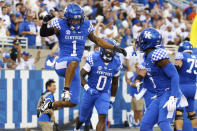 Kentucky wide receiver Wan'Dale Robinson (1) celebrates after scoring a touchdown during the first half of an NCAA college football game against Florida in Lexington, Ky., Saturday, Oct. 2, 2021. (AP Photo/Michael Clubb)