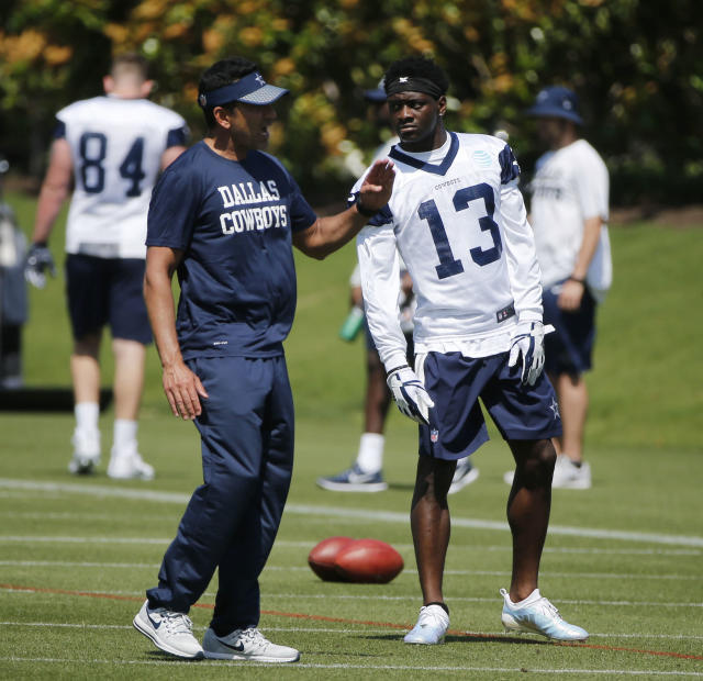 FILE - In this May 11, 2018, file photo, Dallas Cowboys wide receivers coach Sanjay Lal talks to receiver Michael Gallup (13) during the team's NFL football rookie minicamp in Frisco, Texas. Lal replaced Derek Dooley as part of an overhaul of coach Jason Garretts staff. (AP Photo/Michael Ainsworth, File)