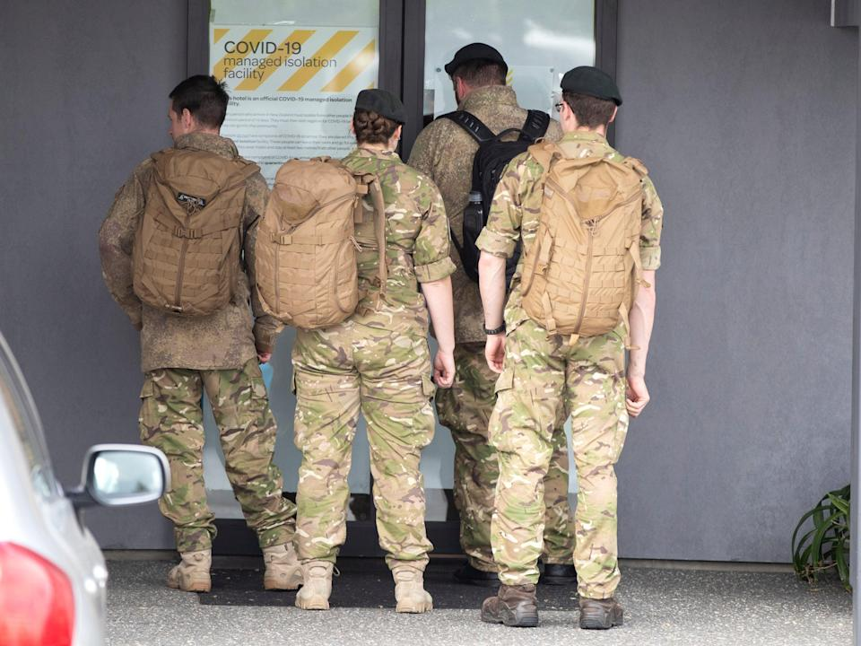 Military personnel arrive at the Sudima Hotel in Christchurch, New Zealand, after fishermen tested positive for Covid (AP)