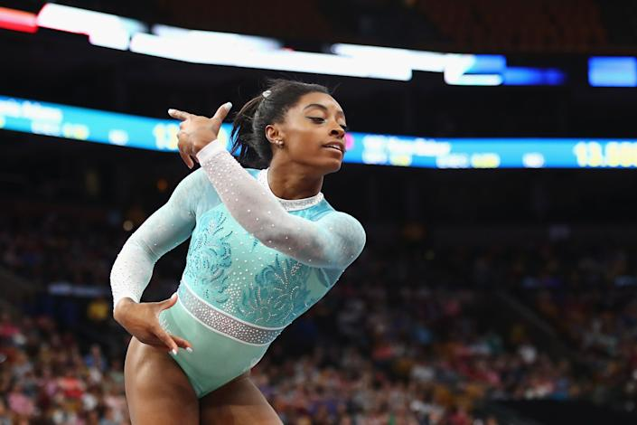 Simone Biles performs in a teal outfit during the floor exercise on Aug. 19. (Photo: Tim Bradbury via Getty Images)