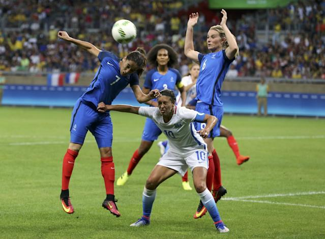 <p>Carli Lloyd (USA) of U.S. in action with Amel Majri (FRA) and Amandine Henry (FRA) of France. REUTERS/Mariana Bazo </p>