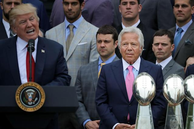 <p>New England Patriots owner Robert Kraft (C) listens to U.S. President Donald Trump deliver remarks during an event celebrating the team's Super Bowl win on the South Lawn at the White House April 19, 2017 in Washington, DC. It was the team's fifth Super Bowl victory since 1960. (Photo by Chip Somodevilla/Getty Images) </p>