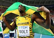 Jamaica's Usain Bolt celebrates after winning the 100 metres final at the 2013 IAAF World Championships at the Luzhniki stadium in Moscow on August 11, 2013
