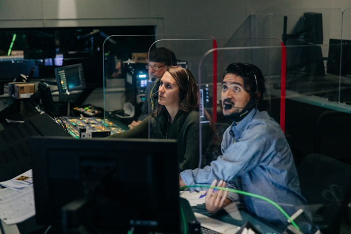 """""""Fox NFL Kickoff"""" director Courtney Stockmal, center, directs a show from the control room."""