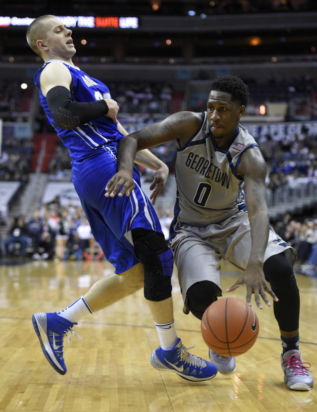 Georgetown center L.J. Peak (0) drives to the basket against Creighton guard Isaiah Zierden, left, during the second half of an NCAA college basketball game, Saturday, Jan. 3, 2015, in Washington. Georgetown won 76-61. (AP Photo/Nick Wass)