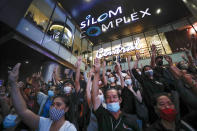 Pro-democracy demonstrators flash a three-finger salute of defiance during a protest rally in the Silom business district of Bangkok, Thailand, Thursday, Oct. 29, 2020. The protesters continue to gather Thursday with their three main demands of Prime Minister Prayuth Chan-ocha's resignation, changes to a constitution that was drafted under military rule and reforms to the constitutional monarchy. (AP Photo/Sakchai Lalit)