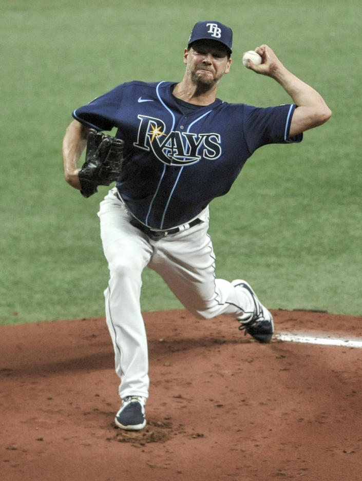 Tampa Bay Rays starter Rich Hill pitches to a Texas Rangers batter during the first inning of a baseball game Thursday, April 15, 2021, in St. Petersburg, Fla. (AP Photo/Steve Nesius)
