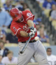 Los Angeles Angels' Chris Iannetta hits a two-run double during the second inning of a baseball game against the Los Angeles Dodgers on Tuesday, Aug. 5, 2014, in Los Angeles. (AP Photo/Jae C. Hong)