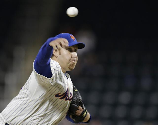 New York Mets starting pitcher Aaron Harang delivers against the San Francisco Giants in the first inning of a baseball game on Wednesday, Sept. 18, 2013, in New York. (AP Photo/Kathy Willens)