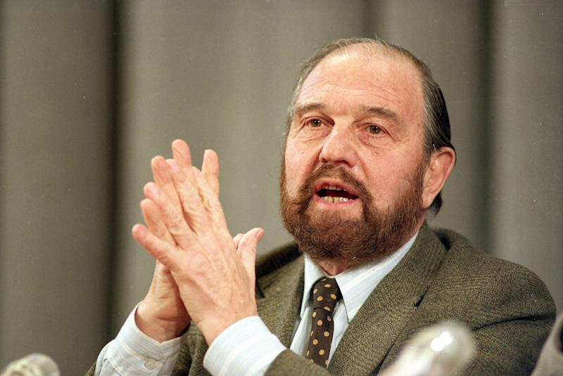 FILE - In this Jan. 15, 1992 file photo, George Blake, a former British spy who doubled as a Soviet agent, gestures during a news conference in Moscow. George Blake, a British double agent, used a ladder made of rope and knitting needles to escape Wormwood Scrubs jail in 1966, five years into his 42-year sentence for treason. With the help of accomplices, he made his way to the border of East Germany hidden in a secret compartment inside a camper van. Blake ended up in the Soviet Union and still lives in Russia, where he receives a KGB pension and last year celebrated his 90th birthday. (AP Photo/Boris Yurchenko, File)