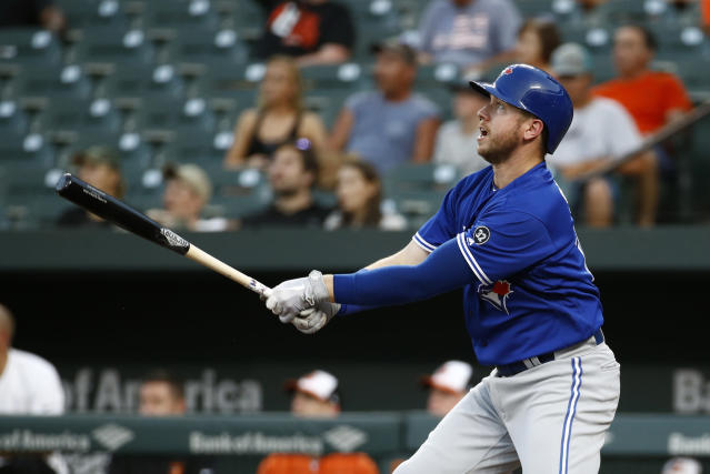 Toronto Blue Jays' Justin Smoak watches his solo home run during the first inning of a baseball game against the Baltimore Orioles, Wednesday, Aug. 29, 2018, in Baltimore. (AP Photo/Patrick Semansky)