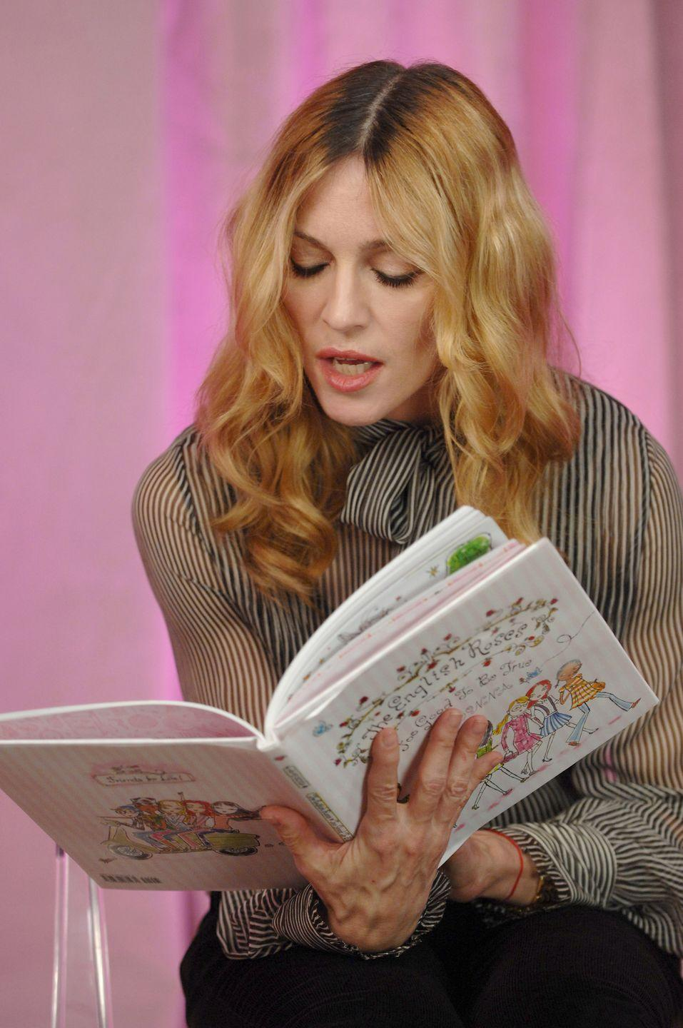 "<p>Madonna has worked on 30 books—11 coffee table books, 12 chapter books, and seven picture books for kids. In terms of her writing career, the Grammy and Academy Award winner is probably best known for her <em>English Roses</em> series, the first of which was published in 2003. </p><p>The books follow the friendship of five girls, and the ups and downs that come with it, and are named after group of friends Madonna's daughter plays with at school, she told <em><a href=""https://www.publishersweekly.com/pw/by-topic/authors/interviews/article/33935-mum-s-the-word-pw-talks-with-madonna.html"" rel=""nofollow noopener"" target=""_blank"" data-ylk=""slk:Publishers Weekly"" class=""link rapid-noclick-resp"">Publishers Weekly</a></em>. The idea for the series was planted by the Queen of Pop's Kabbalah teacher, who suggested she write children's books to ""share the wisdom you've gained as an adult."" The first book in the series debuted at number one on the <em><a href=""https://sanoma.com/release/madonnas-book-the-english-roses-debuts-at-no-1-on-the-new-york-times-childrens-best-seller-list/"" rel=""nofollow noopener"" target=""_blank"" data-ylk=""slk:New York Times"" class=""link rapid-noclick-resp"">New York Times</a></em> children's bestsellers list. <br></p><p><a class=""link rapid-noclick-resp"" href=""https://www.amazon.com/English-Roses-Madonna/dp/0670036781?tag=syn-yahoo-20&ascsubtag=%5Bartid%7C2139.g.34385633%5Bsrc%7Cyahoo-us"" rel=""nofollow noopener"" target=""_blank"" data-ylk=""slk:Buy the Book"">Buy the Book</a></p>"
