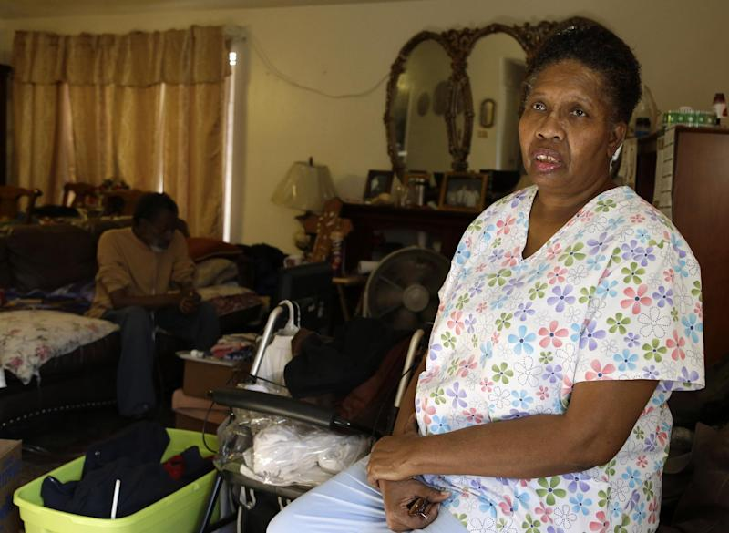 This photo taken Jan. 18, 2013 shows part-time home health care provider Debra Walker in her home in Houston. President Barack Obama thinks his health care law makes states an offer they can't refuse. Whether to expand Medicaid _the federal-state program for the poor and disabled_ could be the most important decision facing governors and legislatures this year. The repercussions go beyond their budgets, directly affecting the well-being of residents and the finances of critical hospitals. Awaiting decisions are people like Walker, a part-time home health care provider. She had a good job with health insurance until she got laid off in 2007.  (AP Photo/Pat Sullivan)