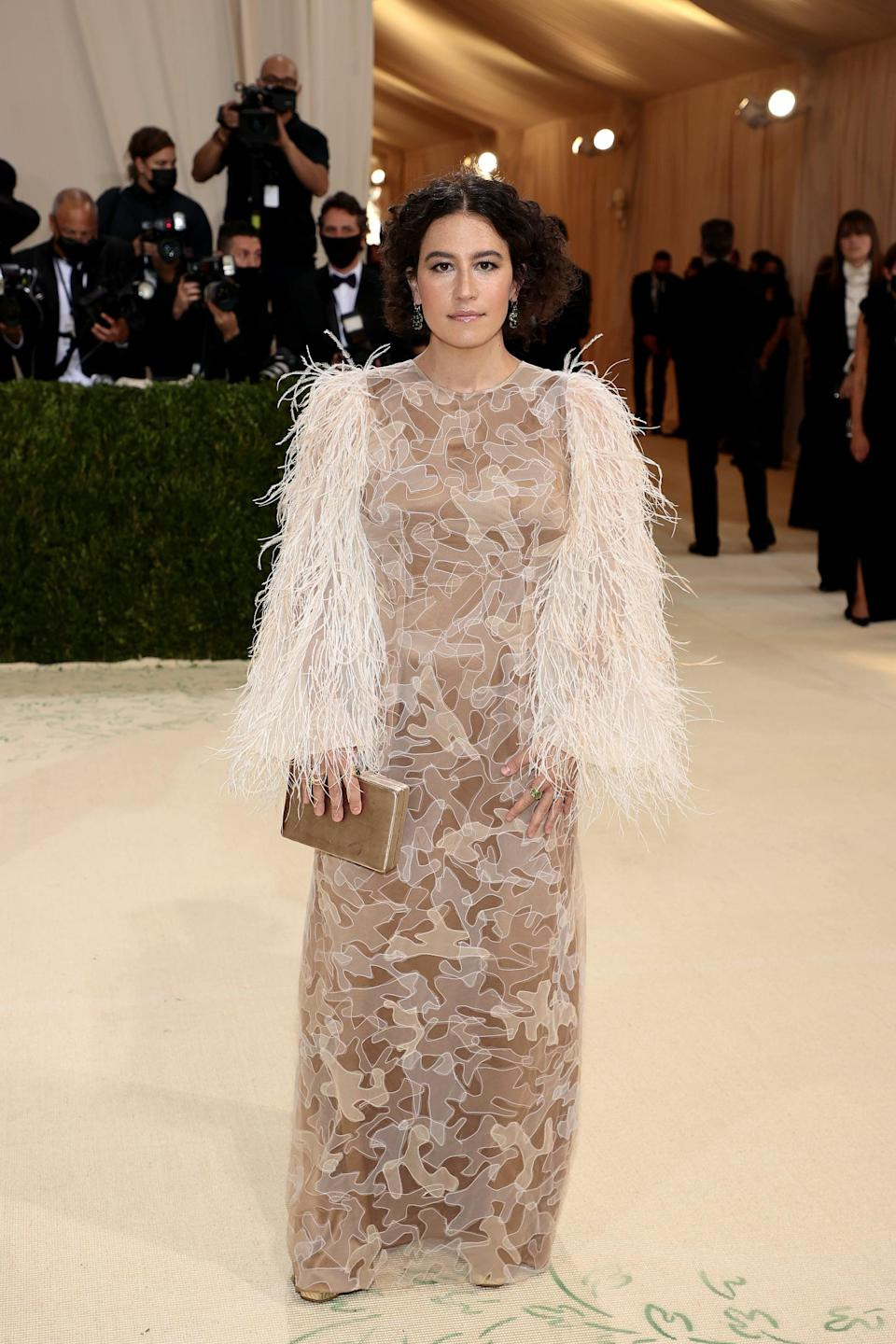 <p>Ilana Glazer rocked a custom, tulle Aliétte gown with feathered sleeves by founder Jason Rembert.</p>