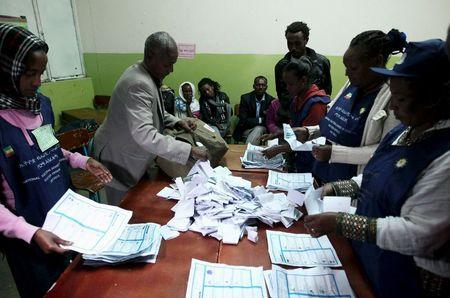 Election officials count votes at the end of the voting exercise in Ethiopia's capital Addis Ababa