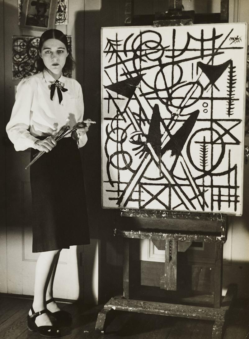 Michael West in her studio with Black and White (1947), 1947.
