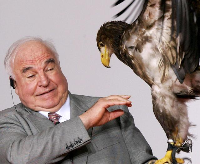 <p>Former German Chancellor Kohl reacts as an eagle sits on his hand during the 'Point Alpha Award' ceremony near the village of Geisa. Former German Chancellor Helmut Kohl reacts as an eagle sits on his hand during the 'Point Alpha Award' ceremony at the cold war-era U.S. Army observation post point Alpha at the demarcation line between East and West Germany near the village of Geisa, east Germany June 17, 2005. Bush received the inaugural 'Point Alpha Award', that honours outstanding contributions to German and European unity along with Kohl and Gorbachev on Friday, the anniversary of a 1953 workers uprising against Communist authorities in East Germany. (REUTERS/Fabrizio Bensch) </p>