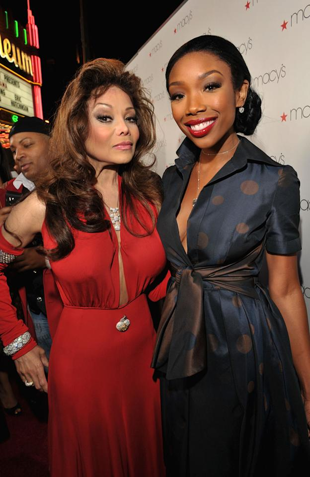 "La Toya Jackson and Brandy caught up on the red carpet Thursday night at the Macy's Passport Presents Glamorama fashion show at the Orpheum Theatre in downtown L.A. Proceeds benefited AIDS Project Los Angeles and Project Angel Food. Lester Cohen/<a href=""http://www.wireimage.com"" target=""new"">WireImage.com</a> - September 16, 2010"