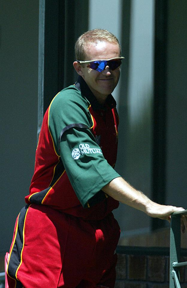 Zimbabwe Batsman Andy Flowers wears a black arm band 10 February 2003, as a sign of protest against the worsening famine and violence tearing his country,  during his team first march vs Namibia in the 2003 World Cup Cricket tournament held in Kenya, South Africa and Zimbabwe from the 09 Febuary till 23 March 2003.  AFP PHOTO Alexander JOE