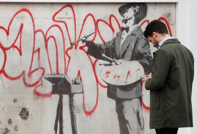 The Banksy mural features an artist believed to be Spanish painter Diego Velazquez (Picture: Reuters)