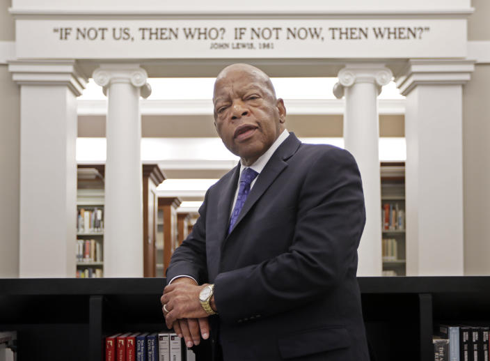 Rep. John Lewis, D-Ga., poses for a photograph under a quote of his that is displayed in the Civil Rights Room in the Nashville Public Library Friday, Nov. 18, 2016, in Nashville, Tenn.  (Photo: Mark Humphrey/AP)