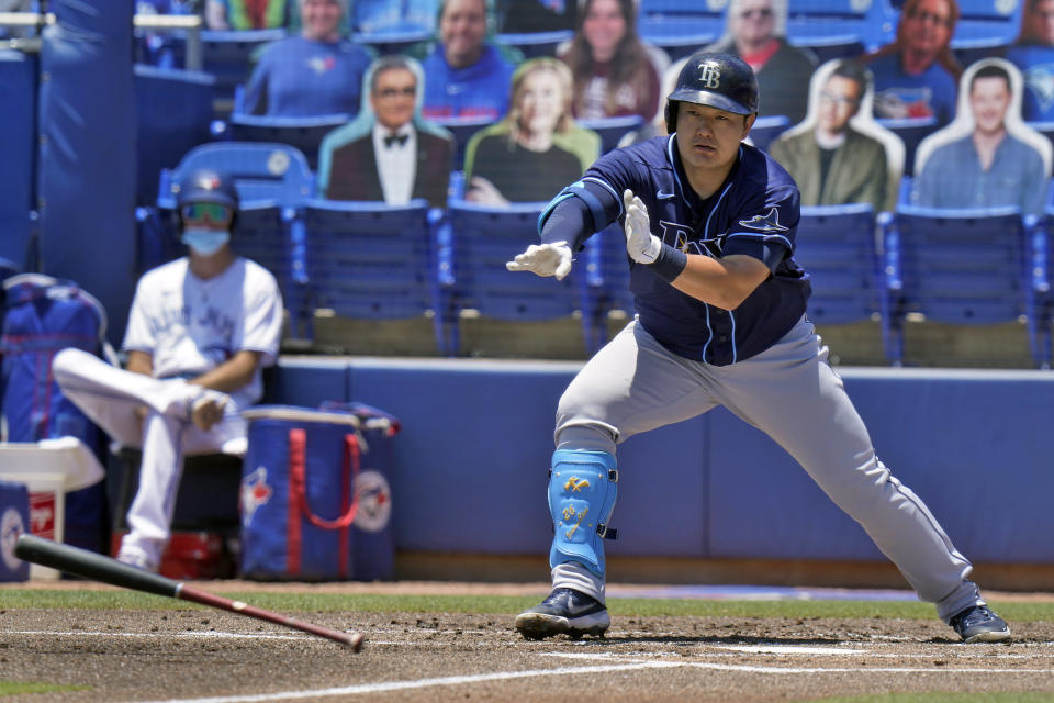Tampa Bay Rays' Ji-Man Choi loses his bat after taking a wild swing on a pitch by Toronto Blue Jays' Trent Thornton during the first inning of a baseball game Monday, May 24, 2021, in Dunedin, Fla. (AP Photo/Chris O'Meara)