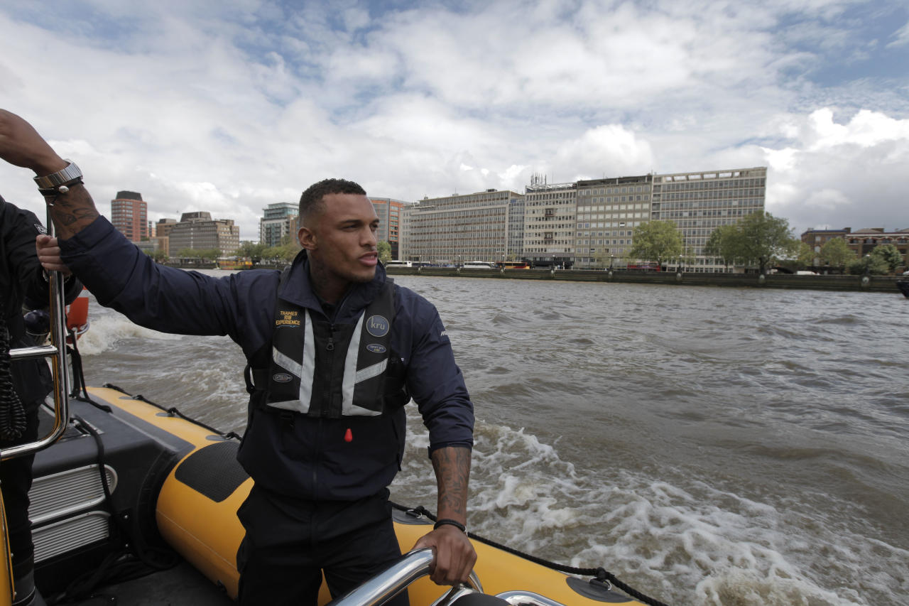 In this Wednesday, July 4, 2012, David McIntosh, a former British Royal marine, currently employed by the Protection Services International company, travels on London's river Thames. Companies like Protection Services International are just one of the many catering to the super rich who are coming to the London games and demand top security and easy transport. (AP Photo/Lefteris Pitarakis)