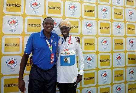 Athletics - TCS World 10K race - Bengaluru, India, May 27, 2018. Kenya's coach Patrick Sang (L) and Geoffrey Kipsang Kamworor pose after Kamworor won the race. Picture taken May 27, 2018. REUTERS/Abhishek N. Chinnappa