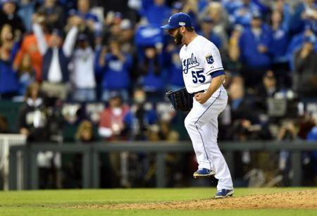 Oct 28, 2014; Kansas City, MO, USA; Kansas City Royals relief pitcher Tim Collins (55) celebrates after defeating the San Francisco Giants during game six of the 2014 World Series at Kauffman Stadium. Mandatory Credit: Peter G. Aiken-USA TODAY Sports