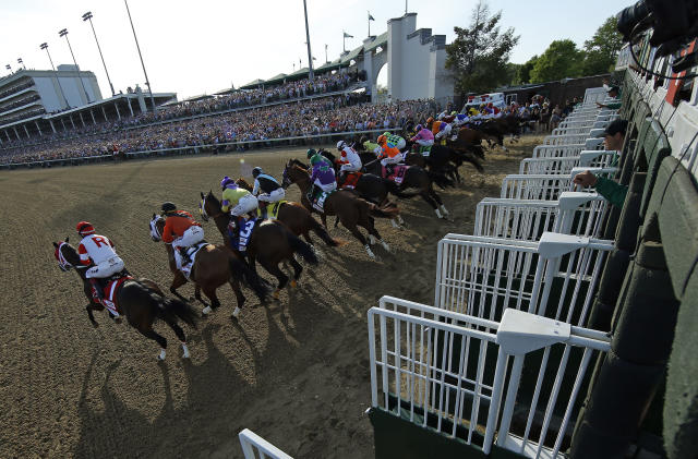 FILE - In this May 3, 2014, file photo, the field breaks from the starting gate during the 140th running of the Kentucky Derby horse race at Churchill Downs in Louisville, Ky. Horses running in the Kentucky Derby will break from a new custom-made 20-stall starting gate for the 146th edition in May. Churchill Downs said Monday, Feb. 3, 2020, the new contiguous gate will eliminate the wide gap between post position No. 14 in the standard gate and No. 15 in the auxiliary gate. (AP Photo/Matt Slocum, File)
