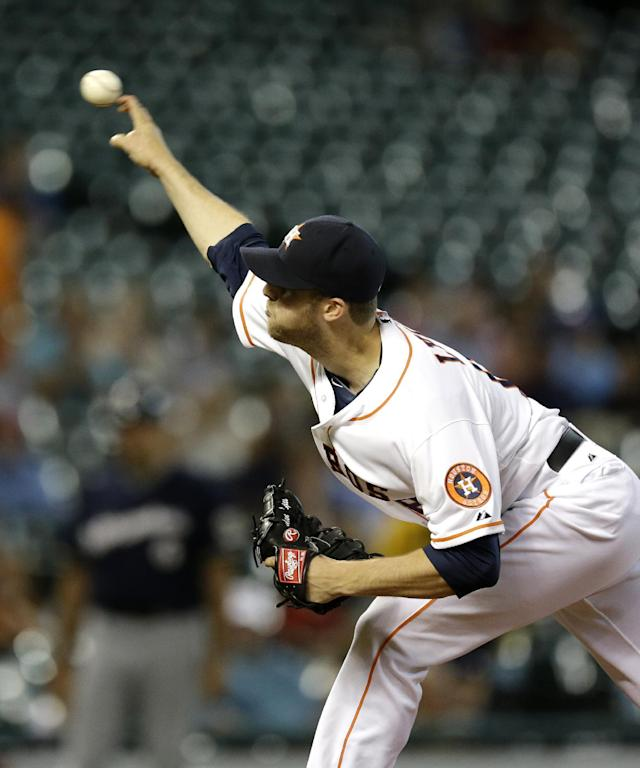 Houston Astros starting pitcher Jordan Lyles throws against the Milwaukee Brewers during the first inning of a baseball game Tuesday, June 18, 2013, in Houston. (AP Photo/David J. Phillip)