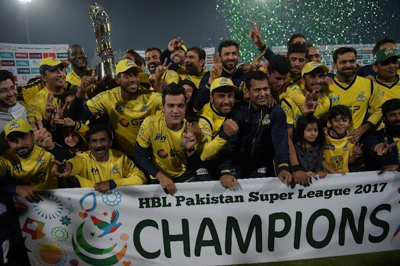 Cricketers of Peshawar Zalmi their victory over Quetta Gladiators in the final cricket match of the Pakistan Super League (PSL) at The Gaddafi Cricket Stadium in Lahore on March 5, 2017