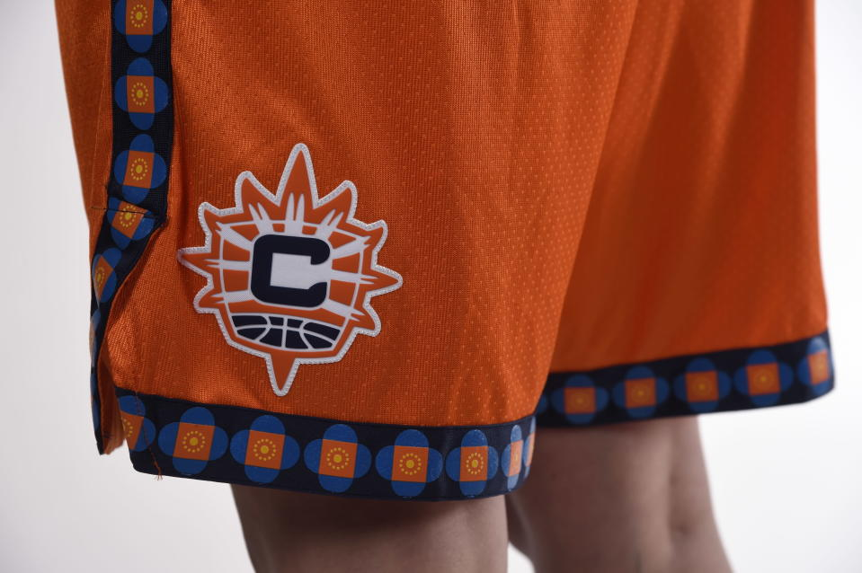 """This photo provided by Connecticut Sun on Thursday, April 8, 2021, shows the new Nike """"Explorer"""" edition uniform for the Connecticut Sun WNBA team. As numerous sports teams continue to come under fire for using Native American names and symbols, The Connecticut Sun is putting them on their new jerseys with the input of the team's owners—the Mohegan Indian tribe. (Connecticut Sun/Khoi Ton via AP)"""