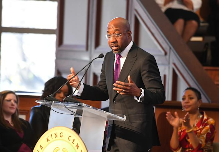 Reverend Raphael G. Warnock, senior pastor of Ebenezer Baptist Church, speaks on stage during the 2019 Martin Luther King Jr. Memorial.  (Photo courtesy of Pallas Griffin/Getty Images)