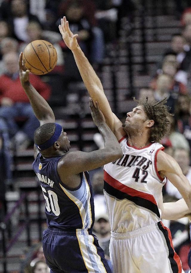 Memphis Grizzlies forward Zach Randolph, left, shoots over Portland Trail Blazers center Robin Lopez during the second half of an NBA basketball game in Portland, Ore., Tuesday, Jan. 28, 2014. Randolph led the Grizzlies in scoring with 23 points and pulled in ten rebounds as they beat the Trail Blazers 98-81. (AP Photo/Don Ryan)