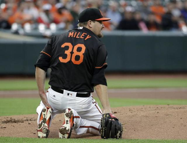 Baltimore Orioles pitcher Wade Miley kneels after being hit by a line drive single by Avisail Garcia of the White Sox. (AP)