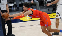 Oklahoma City Thunder forward Isaiah Roby reaches out to pull in a loose ball against the Denver Nuggets in the first half of an NBA basketball game Tuesday, Jan. 19, 2021, in Denver. (AP Photo/David Zalubowski)