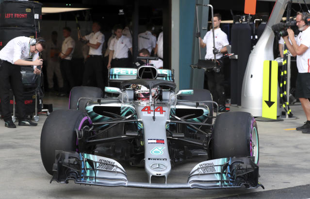 Mercedes driver Lewis Hamilton of Britain leaves his garage during qualifying at the Australian Formula One Grand Prix in Melbourne, Saturday, March 24, 2018. (Glenn Nicholls/Pool via AP)