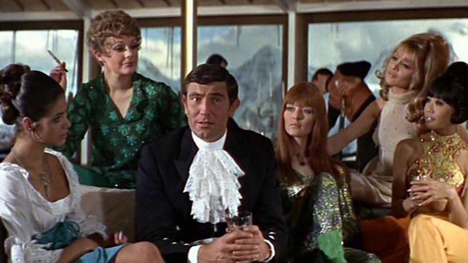 """<p> Famously, this is the only Bond movie with George Lazenby in the title role. A surprise choice, given his limited movie experience, the star was better known for modelling underwear than pretending to save the world. Still, despite bringing an outrageously '60s vibe to Bond, which was later mercilessly parodied by Austin Powers, Lazenby's outing is one of the better movies in the whole franchise. It's actually one of the most fondly thought-of novels. The plot sees Bond pursuing Blofeld into the Swiss Alps where his arch nemesis has set up a clinic for the treatment of severe allergies. Of course, it's all a front. The 12 sexy ladies Blofeld is supposedly treating are actually being hypnotised, turning them into agents who the criminal mastermind will use to distribute poisonous biological gasses into the Western world. The movie holds up surprisingly well, and Lazenby makes a decent 007 - such a shame we didn't see more from him. The biggest misstep is that Bond gets married, something die-hard fans were up in arms about, although his bride's untimely death at the end of the film was a bold choice from the filmmakers, and it remains one of the most memorable and tragic moments in the whole franchise. In terms of presenting Bond as a human being, rather than a killing/sex machine, it's only matched by the """"the b**** is dead"""" finale of Casino Royale. </p> <p> <strong>Bond:</strong> George Lazenby<br> <strong>Theme tune:</strong> We Have All the Time in the World by Louis Armstrong </p>"""