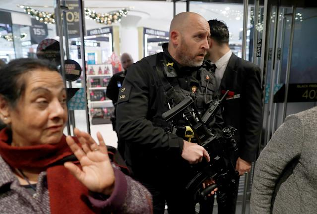<p>Armed police officers mix with shoppers in an Oxford Street store, in London, Britain on Nov. 24, 2017. (Photo: Peter Nicholls/Reuters) </p>
