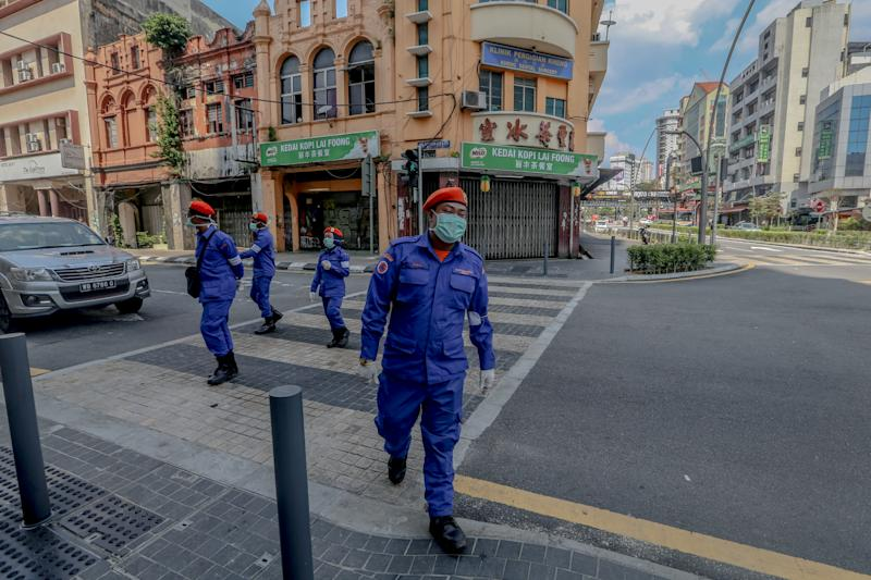 Malaysia Civil Defence Force patrol in Kuala Lumpur, on March 20, 2020, as Malaysia enters the third day of a two-week shutdown to combat the Covid-19 outbreak. (Photo by Mohd Daud/NurPhoto via Getty Images)