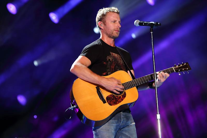 FILE - In this June 8, 2013 file photo, Dierks Bentley performs at LP Field in Nashville Tenn. Bentley is organizing a July 22 benefit concert at Tim's Toyota Center in Prescott Valley, Ariz., for the families of 19 firefighters from Prescott Fire Department's Granite Mountain Hotshots who were killed while on duty. (Photo by John Davisson/Invision/AP, File)