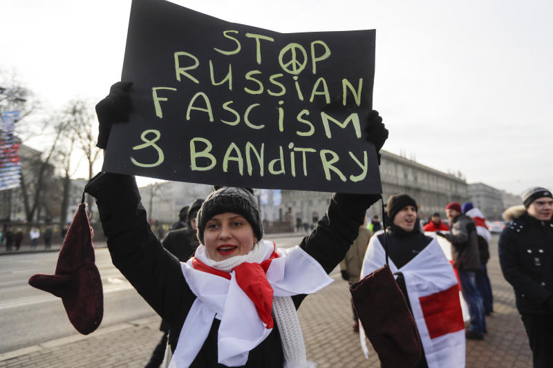 A protester holds a banner during a rally in downtown Minsk, Belarus, Saturday, Dec. 7, 2019. Several hundreds demonstrators gathered to protest against closer integration with Russia. (AP Photo/Sergei Grits)