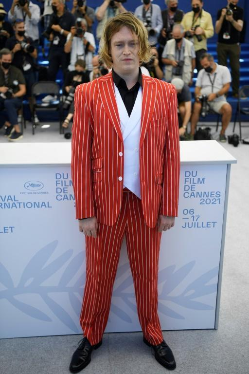 """US actor Caleb Landry Jones, star of """"Nitram"""" at the Cannes film festival, poses in one of his orange suits"""